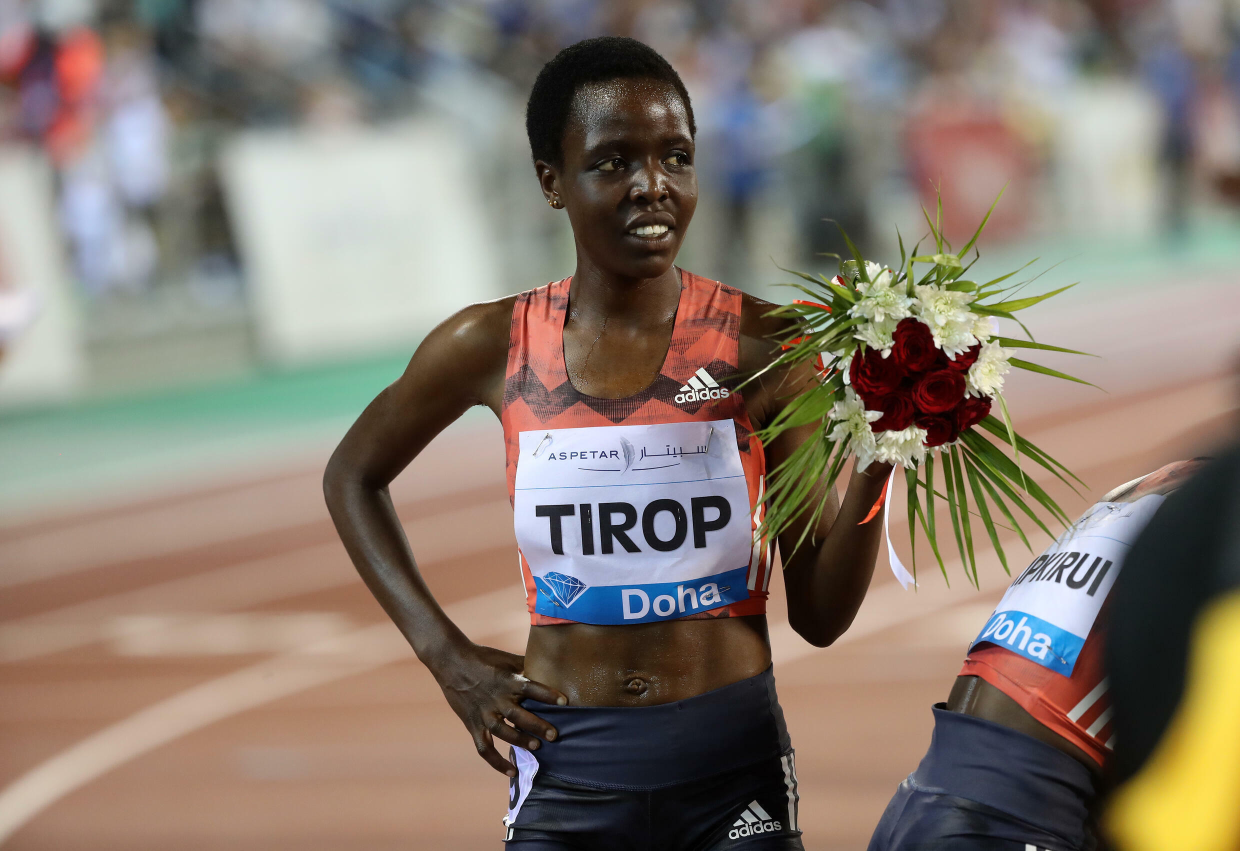 FILE - Kenyan athlete Agnes Jebet Tirop celebrates her second place finish in the 3,000-meter Diamond League athletics event in Doha, Qatar, on May 4, 2018.