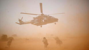 FILE PHOTO: A NH 90 Caiman military helicopter takes-off during the regional anti-insurgent Operation Barkhane in Inaloglog, Mali, October 17, 2017. Picture taken October 17,