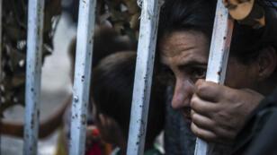 Des migrants à Presevo, en Serbie, à la frontière avec la Macédoine, le 24 août 2015.