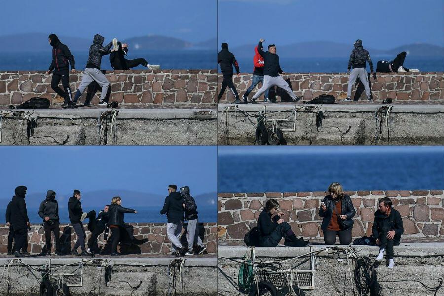 Un journaliste est attaqué par des résidents de Lesbos qui tentent d'empêcher une embarcation de migrants de débarquer sur l'île, le 1er mars 2020. Une femme vient ensuite à son secours.