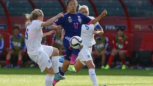 Yuki Ogimi of Japan battles Katie Chapman and Steph Houghton of England during the FIFA Women's World Cup Semi Final match between Japan and England on July 1, 2015.