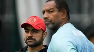 Afghanistan's Rashid Khan (left) and head coach Phil Simmons attend a training session at Old Trafford