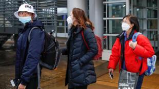 Des passagers arrivant de Chine à l'aéroport de Chigago, le 24 janvier 2020.