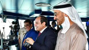 Egyptian President Abdel Fattah al-Sisi (C)inaugurates a new naval base on the Mediterranean Sea flanked by Abu Dhabi Crown Prince Sheikh Mohammed bin Zayed Al-Nahyan (R)