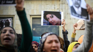 Demonstrators in Cairo hold a picture of Shaima Sabbagh (centre) during a rally to protest her killing by police on January 24, 2015