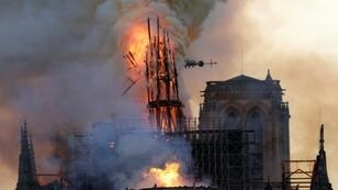 The International Olympic Committee on Thursday pledged 500,000 euros ($562,0000 to help ensure Notre Dame is restored in time for the 2024 Paris Games