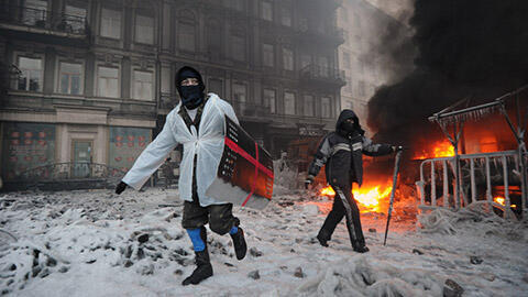 Clashes between protesters and police at Maidan square in central Kiev