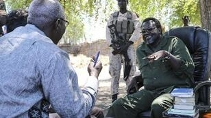 UN Special Advisor for the Prevention of Genocide Adama Dieng speaks with rebel chief Riek Machar in 2014.
