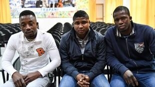 (From l) Ivorian Fofana Lamine, 25, Gambian Cherno Jallow, 22 and Senegalese Cheikhaya Dieng, 26, are due to be released from an Italian jail