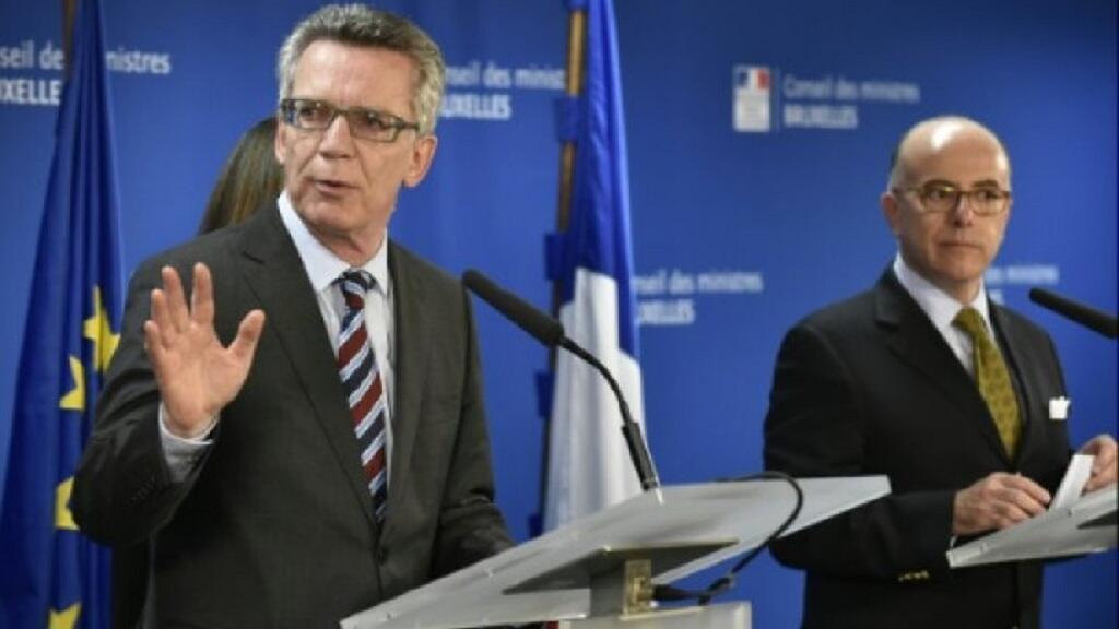 - وزيرا الداخلية الألماني والفرنسي في بروكسل في 14 أيلول/سبتمبر 2015