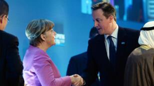 La chancelière allemande Angela Merkel et le Premier ministre britannique David Cameron, le 4 février à Londres, lors de la conférence des donateurs sur la Syrie.