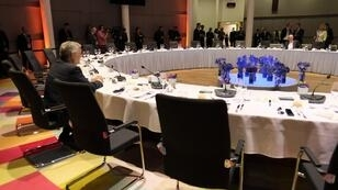 رئيس المفوضيةالأوروبية جان كلود يونكر والرئيس الفرنسي إيمانويل ماكرون والمستشارة الألمانية أنغيلا ميركل في باريس في 26 آذار/مارس 2019