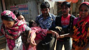 En marge d'une violente manifestation à Ashulia, au Bangladesh.