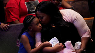 Roxie Washington holds Gianna Floyd, the daughter of George Floyd as they attend the funeral service for George Floyd at The Fountain of Praise church Tuesday, June 9, 2020, in Houston.