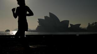 The Sydney Opera House is seen as a smoke haze hits Sydney, Australia, on November 19, 2019.