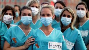 2020-06-30T000000Z_864732898_RC2UJH9TTYTT_RTRMADP_3_HEALTH-CORONAVIRUS-FRANCE-HEALTH-PROTEST
