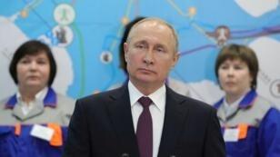 الرئيس الروسي فلاديمير بوتين خلال افتتاحه لمحطتي كهرباء في القرم - 18 مارس/ آذار 2019