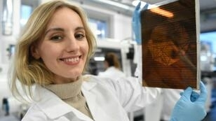 Polish physicist and businesswoman Olga Malinkiewicz poses with a printed solar panel