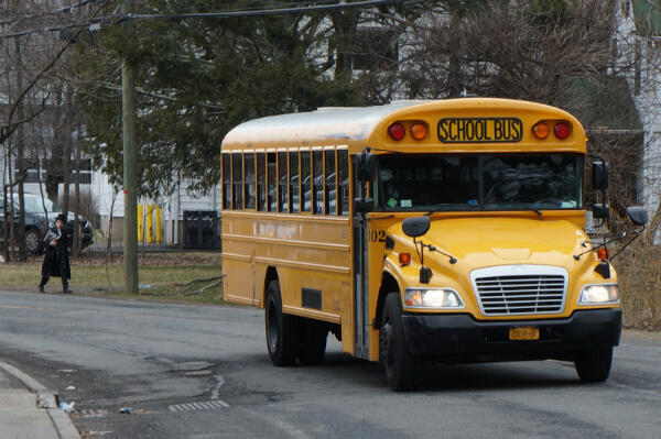 A school bus passes in the Orthodox Jewish community of Monsey, Rockland County, New York.