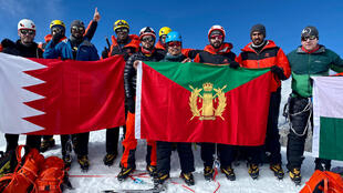 An party from the Bahrain Royal Guard mountaineering team, including a member of the royal family and three Britons, pose for photographs on Lobuche in this picture from Seven Summit Treks