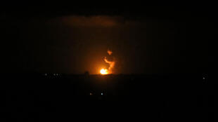 A ball of fire is seen following an Israeli airstrike at Khan Yunis in the southern Gaza Strip early on June 27