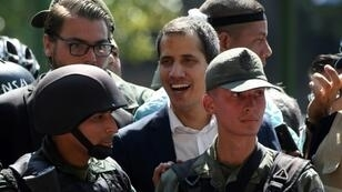 """A Brazilian official confirmed there had been """"various applications"""" from Venezuelan soldiers for asylum in the embassy in Caracas after self-declared president Juan Guaido (C) claimed soldiers had joined him"""