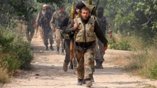Des combattants du Front al-Nosra, faction qui compose l'Armée de la conquête, le 19 mai 2015, dans la région d'Idlib.