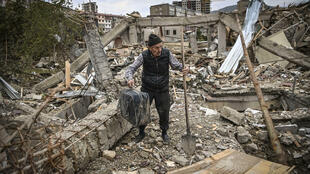 Guennadi Avanessian's home in a well-off street in the capital of war-hit Nagorno-Karabakh region was smashed to pieces