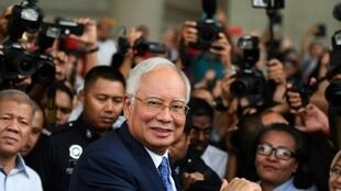 Former prime minister Najib Razak (shown at the start of his trial on April 3) and his cronies are accused of stealing billions of dollars from 1MDB and spending it on everything from high-end real estate to artworks and a luxury yacht