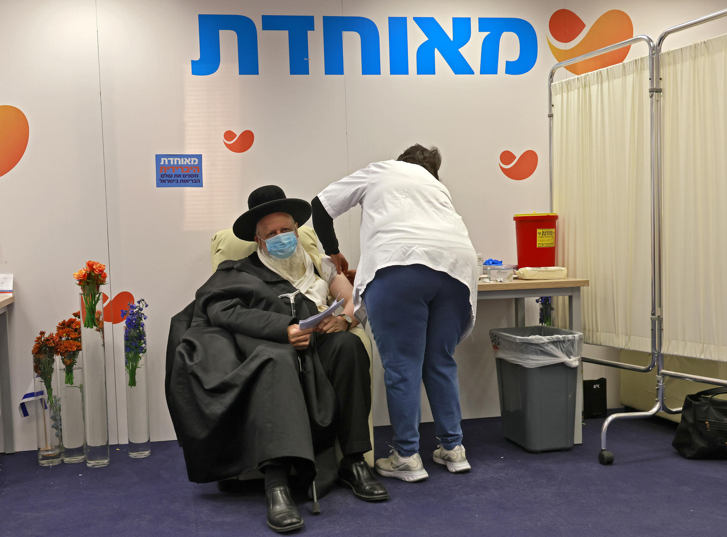 Experts say that beyond the purchase of the vaccine, much of the responsibility for Israel's seemingly smooth deployment belongs to the country's health funds.
