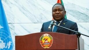 "Mozambique President Filipe Nyusi, pictured here on July 11, has vowed to ""fight and hunt"" militants who have staged raids on remote communities"