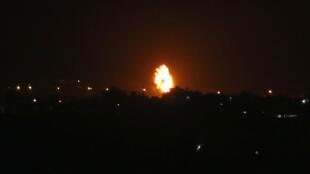 A fireball rises over the Gaza Strip city of Khan Yunis following an Israeli air strike