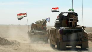 Des forces irakiennes à la base militaire de Qayyarah, environ 60 km au sud de Mossoul, le 16 octobre 2016.