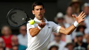 Le Serbe Novak Djokovic a remporté son cinquième tournoi de Wimbledon en battant Roger Federer, le 14 juillet 2019.