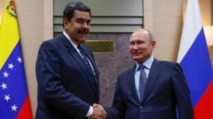 Moscow sent two TU-160 bombers to Venezuela December 2018 days after Russian President Vladimir Putin (R) met with Venezuela's Nicolas Maduro met in Moscow