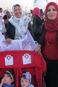 Al-Watan's Radia Alwerimmi (left) at a campaign rally.