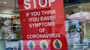 A poster in the window of a pharmacy is pictured in Royal Wharf as the spread of the coronavirus disease (COVID-19) continues, in London, Britain, March 31, 2020.