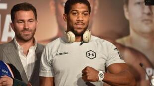 Eddie Hearn (left) is the promoter of heavyweight world champion Anthony Joshua