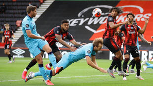 Tottenham's Harry Kane was denied a penalty after being pushed by Bournemouth's Josh King