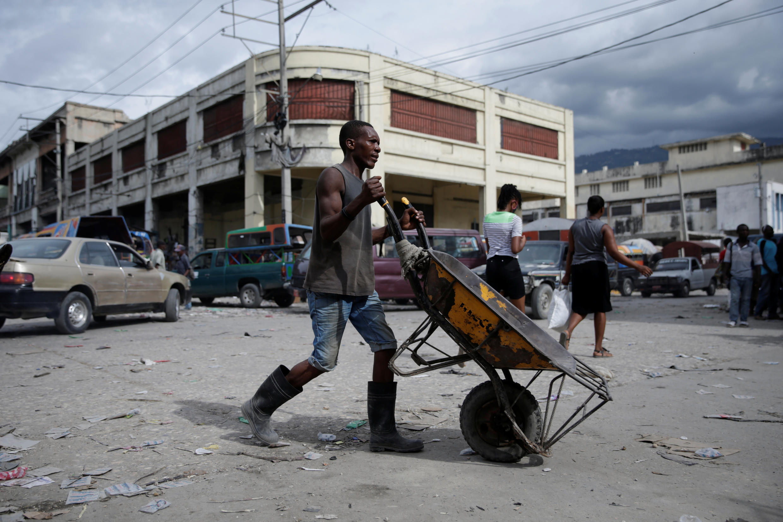 A man pushes an empty wheelbarrow as he walks along a street in Port-au-Prince, Haiti July 30, 2020.