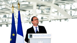 "French president francois Hollande makes a speech during the inauguration of the ""Memorial Act"", for slavery remembrance on May 10, 2015, in Pointe-à-Pitre, as part of a five day visit in the caribbean, including La Martinique, La Guadeloupe, Cuba and Haiti"