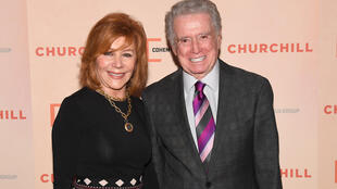 In this file photo taken on May 22, 2017, Regis Philbin (R) and his wife Joy attend the premiere of 'Churchill' in New York City