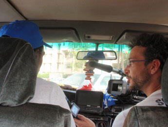 Cameraman Julien Sauvaget - a.k.a. Savage - films as Moussa drives to the cinema. (Photo: L. Jacinto)