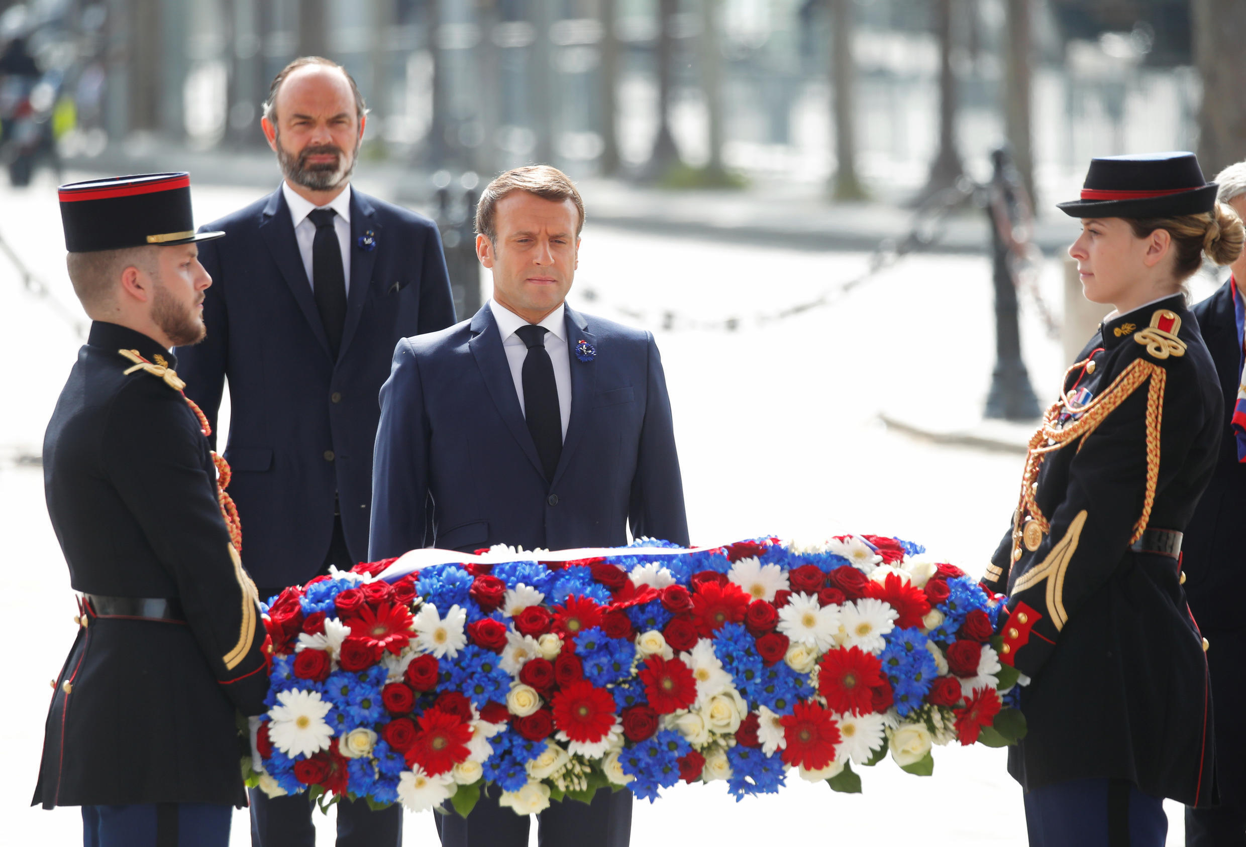 French President Emmanuel Macron and French Prime Minister Edouard Philippe attend a ceremony to mark the end of World War II at the Arc de Triomphe in Paris, France May 8, 2020.