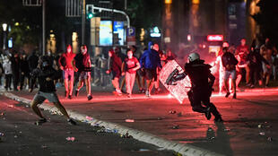 Police clash with protesters near the   National Assembly building in Belgrade, on July 10, 2020, at a demonstration against a weekend curfew announced to combat a resurgence of COVID-19 infections