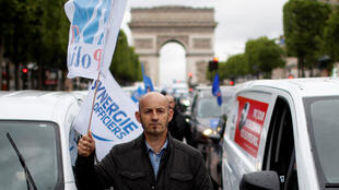 Police officers rally on the Champs-Elysées in Paris to protest against a ban on chokeholds on June 12, 2020.