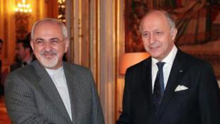 Hassan Rohani et Laurent Fabius, à Paris, le 5 novembre 2013