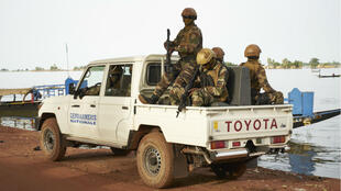 A Malian army pickup truck patrols the streets of Mopti on October 14, 2018.