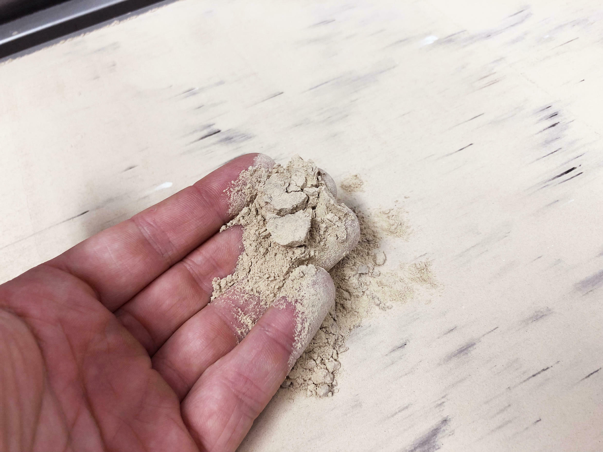 A mixture of limestone and ash loaded into a 3D printer