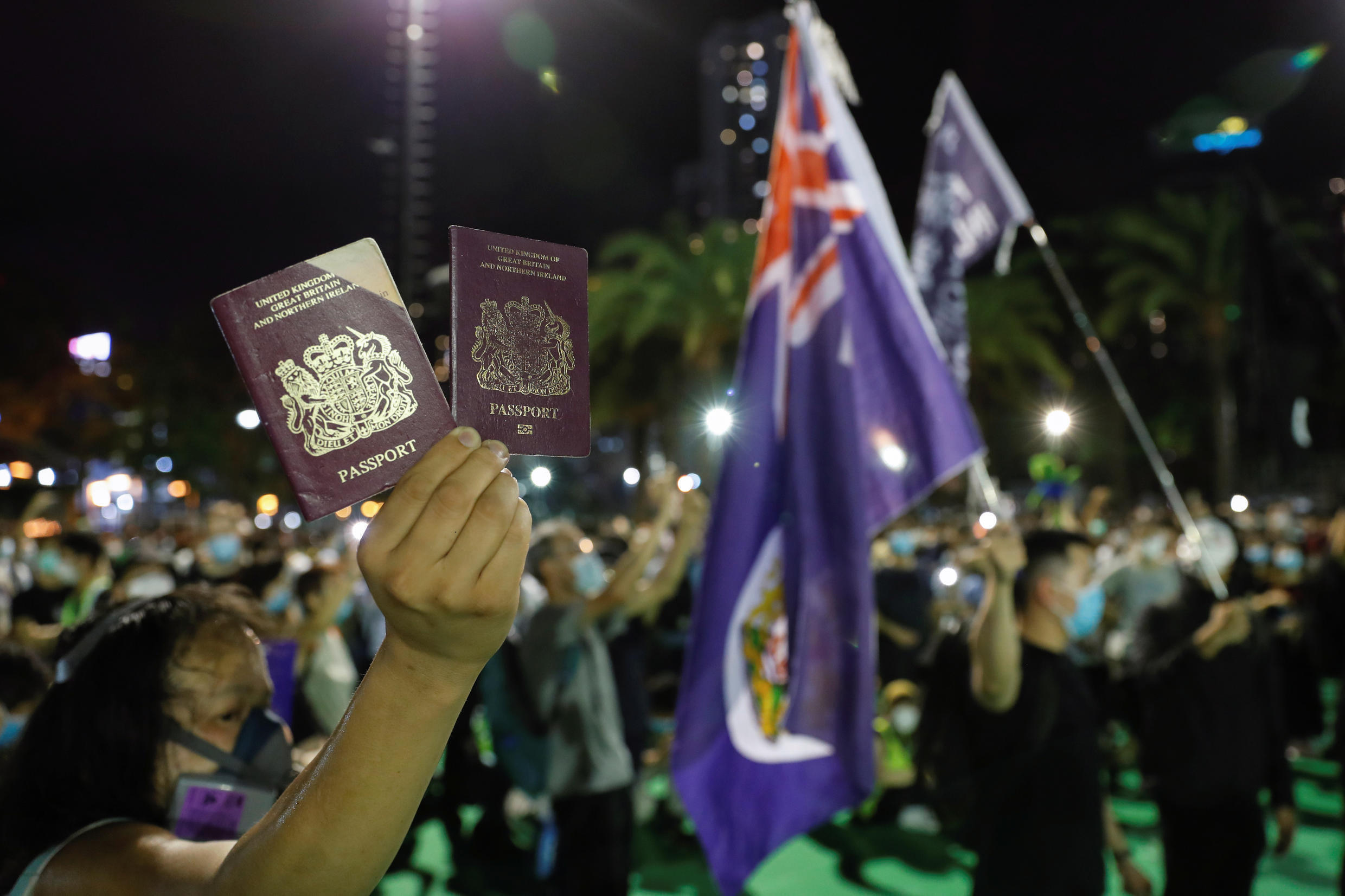 A demonstrator displayed his British foreign passport on June 4, 2020, during a demonstration of the Tianmen Square massacre in Hong Kong.